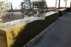 Bomanite integrally colored concrete in a smooth trowel finish was used here to form this beautiful and therapeutic water feature at Clovis Community Medical Center.