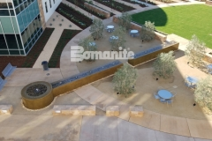 Featured here is Bomanite integrally colored concrete that was smooth trowel finished to add a peaceful, soothing effect to the beautiful water feature in this courtyard space and the design aesthetic is a perfect complement to the surrounding architecture and landscape design.