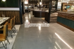 This Bomanite Modena SL polished concrete flooring was custom-colored, ground, and polished to a medium satin finish, adding a distinctive design style that reflects a balance of both old and new world design style and perfectly represents Michael Symon's ode to classic Italian food at his restaurant, Angeline.