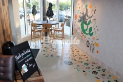 We used Bomanite Modena SL inside this Starbucks to create a polished, highly durable cementitious overlay that was selected as a low-cost concrete flooring alternative that will provide durability and strength while adding a simple, elegant finish that serves as the perfect backdrop for this distinctively colorful mural.