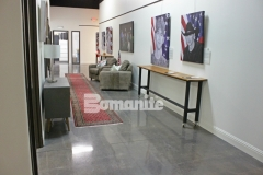Featured here is Bomanite Patene Teres custom polished decorative concrete that was colored using Bomanite Black Orchid concrete dye and Polyurea joint filler in Gauntlet Grey to create a high gloss, sophisticated flooring surface in this gallery space.