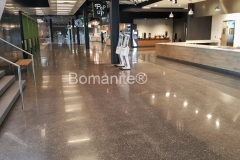 Musselman & Hall Contractors used the Bomanite Renaissance Custom Polishing System at the Cerner Innovations Campus to create a decorative concrete flooring surface that was integrally colored and polished for a lustrous, sophisticated look.