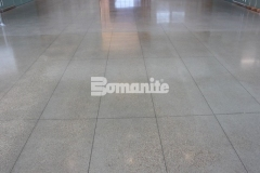 Bomanite VitraFlor custom polished concrete was installed here with a gorgeous, high-polish salt and pepper finish that adds distinctive detail to the flooring and complements the modern design inside the Cypress Waters Business Complex.