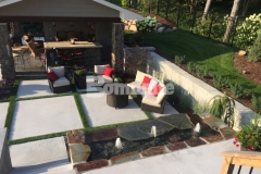 Bomanite Revealed was used to create the steps, landing, and courtyard area in this beautiful backyard retreat and the installation of planting pockets and grass inlays are perfect to break up the expansive concrete and will also help with drainage.