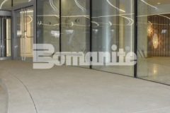 Bomanite Sandscape Refined decorative concrete was installed here to create the grand porte-cochere at 50 Fifty DTC, adding unique details that pair well with the intricate and sophisticated design of this office tower.
