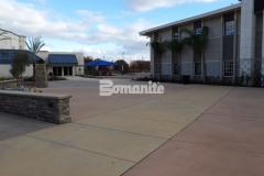 Sandscape Texture decorative concrete by Bomanite was installed here in three different shades, adding visual interest to this exterior hardscape while creating a consistency in texture that connects multiple gathering spaces across this church campus.