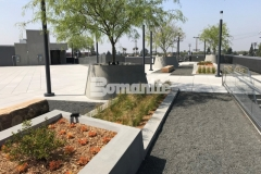 Bomel Construction Company expertly installed a gray Bomanite Exposed Aggregate Sandscape Texture finish to these planters to add textural detail that complements the geometrical arrangement of the pedestal pavers on this rooftop terrace and garden.