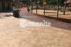Bomanite Bomacron Regular Slate stamped concrete was expertly installed by our colleague, Harrington Bomanite, to create a durable decking surface around this water feature at Canobie Lake Park, adding texture and dimension to the hardscape while providing dimensional detail.