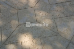 The Bomanite Imprint System was used here with a customized T-shaped graphic to produce a beautiful decorative concrete plaza.