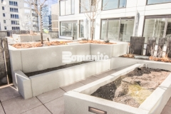 Bomanite Micro-Top ST was applied here over uncolored, form-finished concrete because of its excellent adhesion and weather resistant properties, making it the perfect product to add a decorative and durable concrete finish to these planter walls.