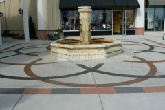 Patene Artectura by Bomanite was used here to create decorative concrete surface with a unique interlocking circular design and random diamond layout decorative scoring and chemical stains to create a relaxing Italian style atmosphere.