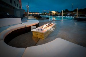 Firepit with seating area has a luxury feel created by the Bomanite Exposed Aggregate Alloy on the pool deck of the Hard Rock Casino in Tulsa, OK, installed by Bomanite of Tulsa.