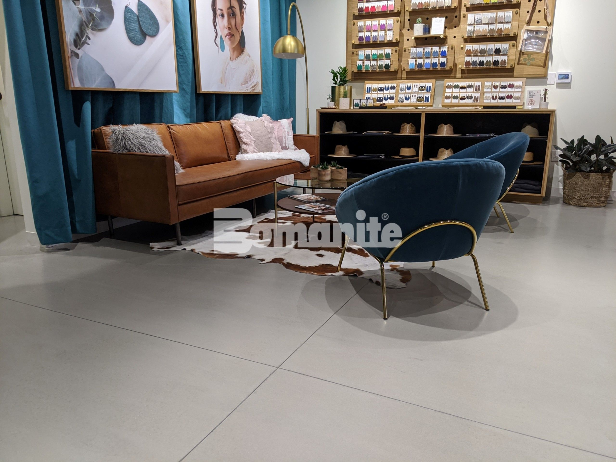Bomanite Modena SL Custom Polished decorative concrete overlay installed in Nickel & Suede's new flagship store by Musselman & Hall Contractors, LLC in Kansas City, MO.